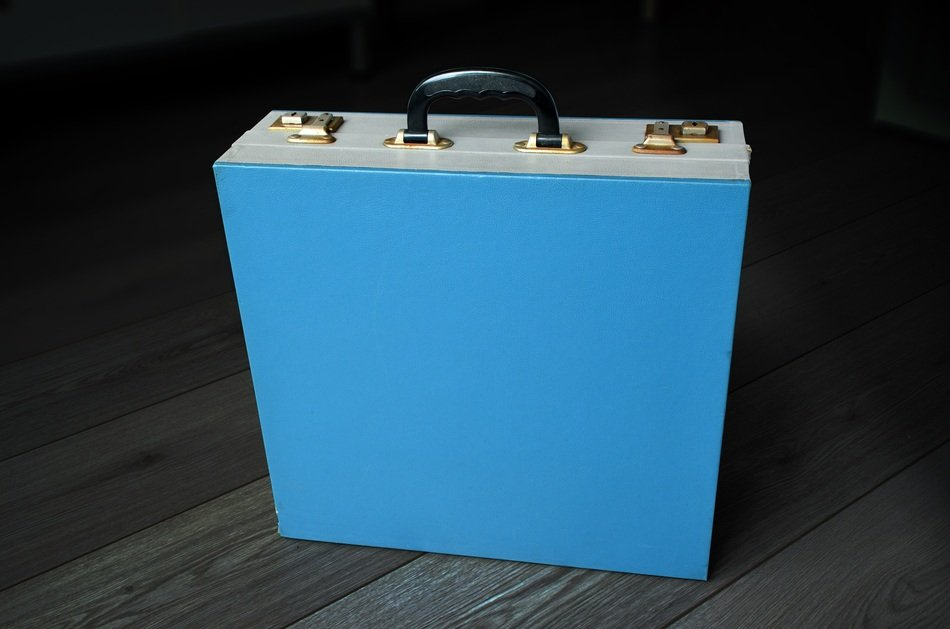 Blue vintage suitcase for singles
