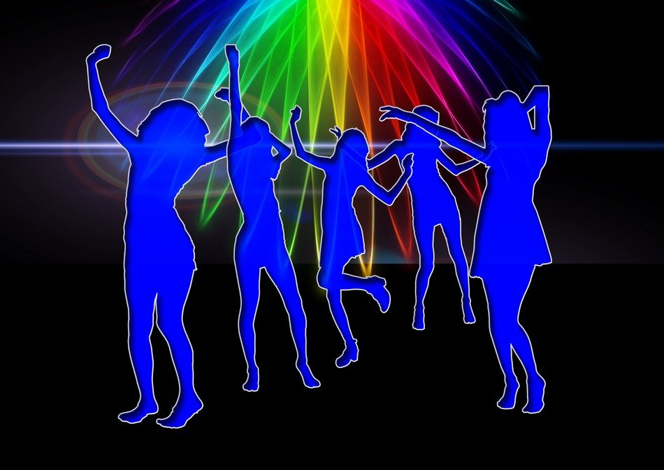 blue silhouettes of people dancing in a nightclub