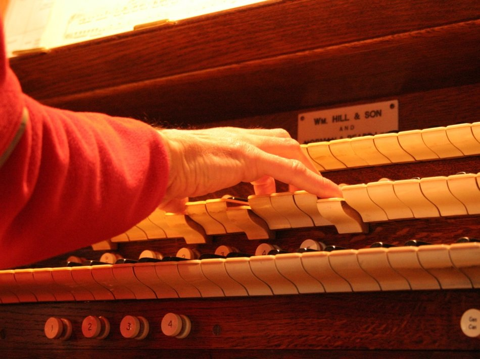 hands on church organ