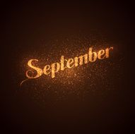 September label with glowing golden sparkles