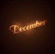 December label with glowing golden sparkles