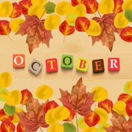 "Autumn background with leaves and colorful letters ""october"""