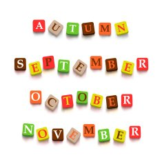 "Words ""autumn"" ""September"" ""October"" ""Novtember"" with colorful blocks"