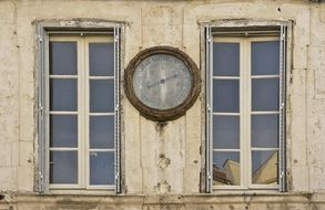 barometer on the facade of an historical building