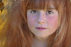 photo of a girl with red hair