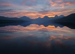 tranquil sunset lake with mountains reflection evening scenic