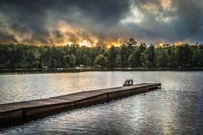 wooden pier on the lake sunset