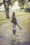 country girl with guitar on the road