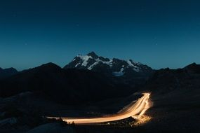 illuminated road in the mountains