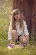 Little girl with long hair in nature