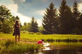 girls fishing near lake scene