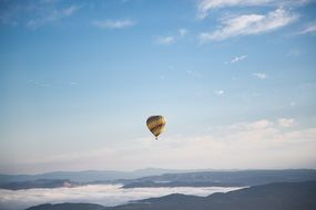 A large balloon against the backdrop of picturesque nature