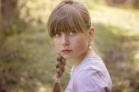 Little girl with a slanting and expressive look