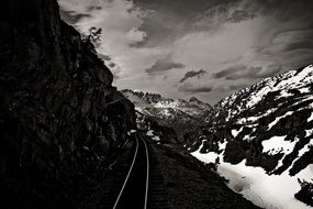 railway tracks in snow mountains