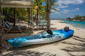 resort blue kayak on sand beach