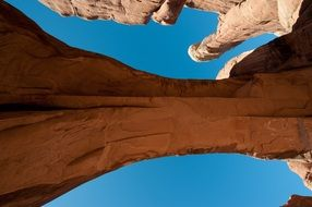 View from below on a stone arch in the national park, america