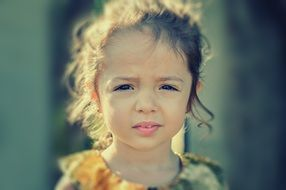 Little girl with a sad look