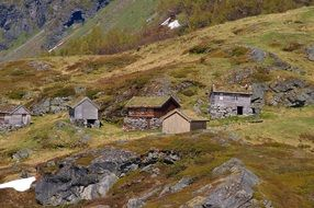 old wooden huts on nature in Norway