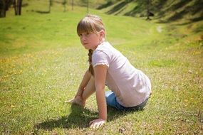 girl posing on the grass
