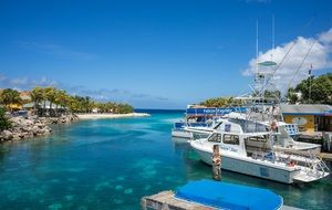Luxury boats in lagoon curacao island blue
