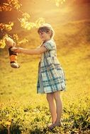 girl playing with teddy bear outdoor