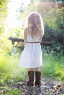 girl in white dress and cowboy boots