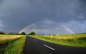 rainbow over a country road in the Czech Republic