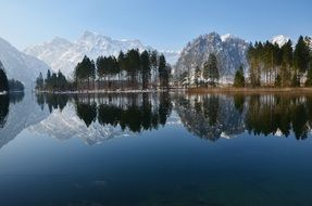 panorama of lake Bergsee on the background of alpine mountains in Austria