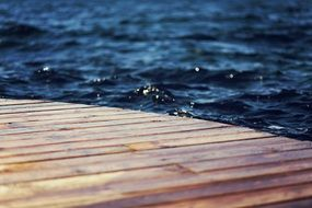 splashing water on pier