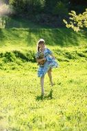 Picture of the girl in a dress on a meadow