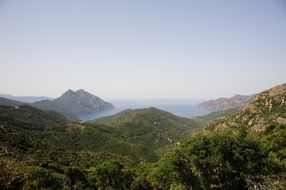 view with green mountains and sea