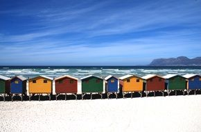 row of beachfront colored cottages