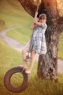 girl swinging on the tire swing