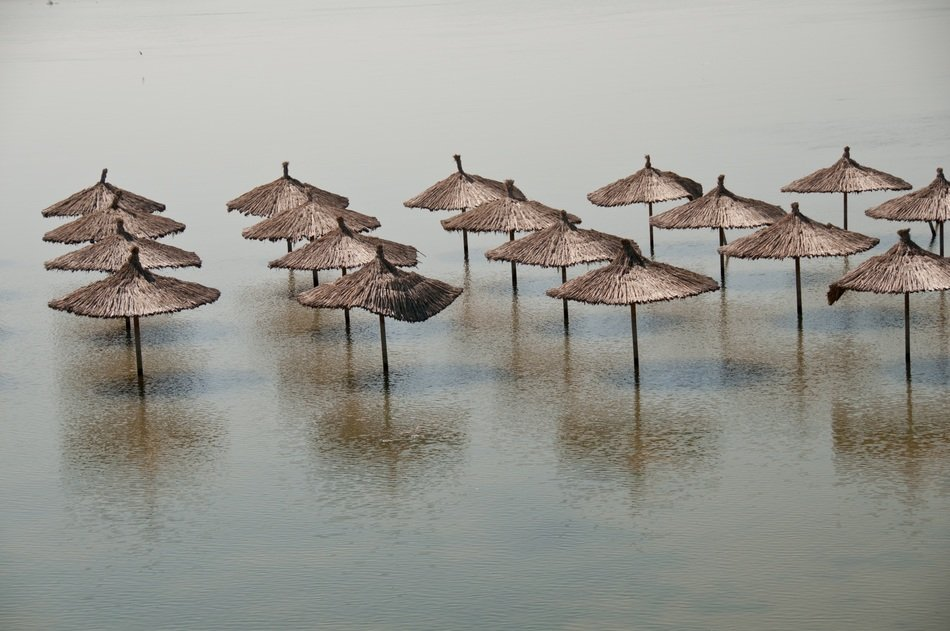 flooded beach umbrellas
