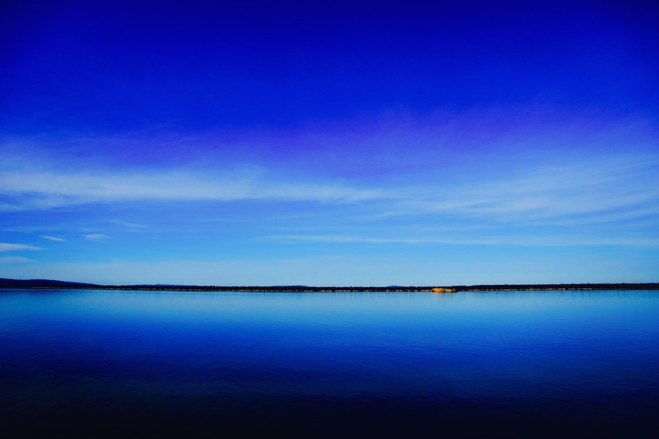 landscape of bright blue sky and sea