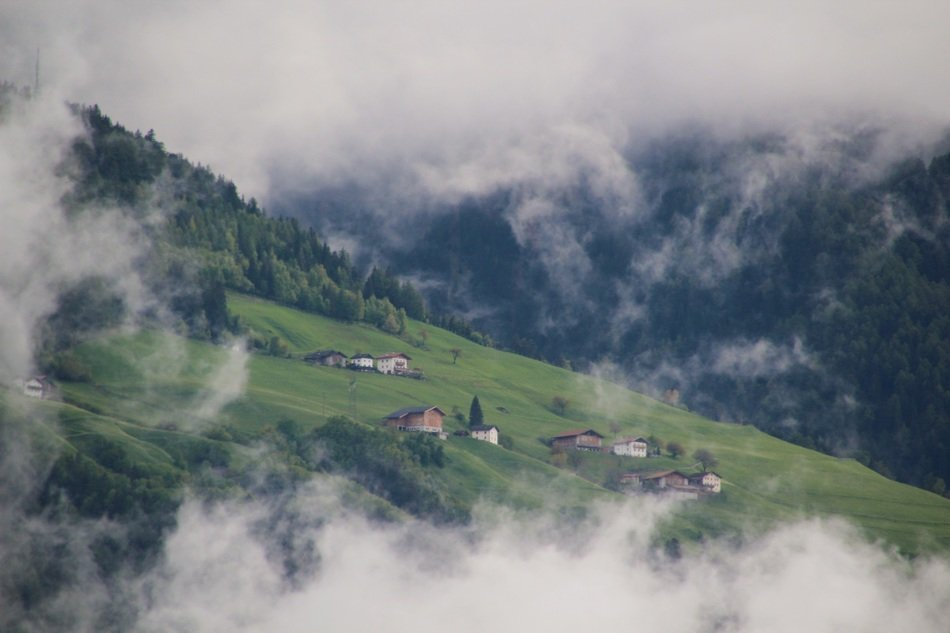 fog over mountain village in South Tyrol