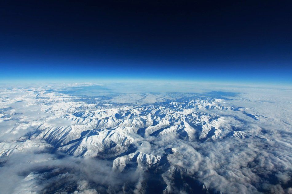 snowy mountains view from space