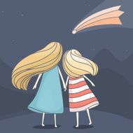 Two girl friends looking at a falling comet