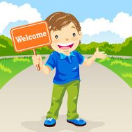 Boy Holding Welcome Sign