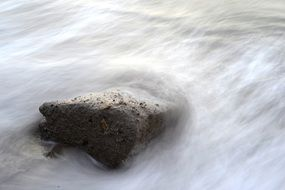 stone in water wave