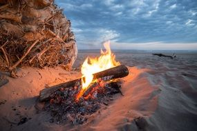 cozy bonfire on the beach in the evening