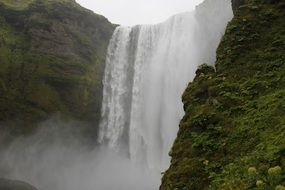 strong waterfall in iceland