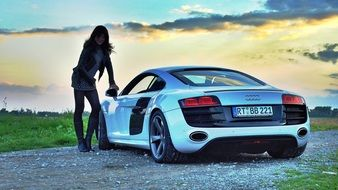 audi r8 and young woman