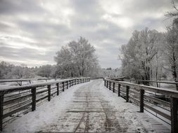 Wooden bridge in the snow