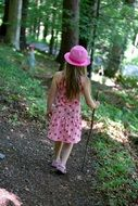 Girl is walking in the forest
