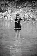 Little girl in rubber boots with an umbrella