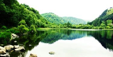 lake among picturesque green hills in ireland