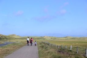 family on bikes in beautiful surroundings