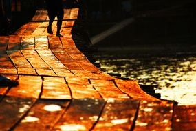 golden walking path on pier at sunset