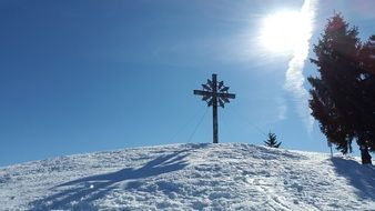 Cross on top of the alpine mountains